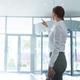 Female executive using invisible digital screen - PhotoDune Item for Sale