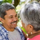 Romantic senior couple looking face to face in garden - PhotoDune Item for Sale