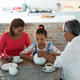 Happy multi-generation family having tea in dining table - PhotoDune Item for Sale