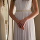 Midsection of bride in dress standing at home - PhotoDune Item for Sale