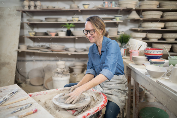 Female potter molding a clay - Stock Photo - Images