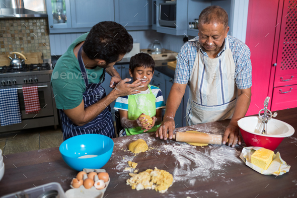 High angle view of playful family preparing food - Stock Photo - Images