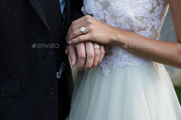 Wedding couple holding hands - Stock Photo - Images