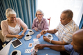 High angle view of senior friends playing cards - PhotoDune Item for Sale