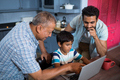 High angle view of father and grandfather looking at boy - PhotoDune Item for Sale