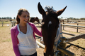 Smiling woman with horse at ranch - PhotoDune Item for Sale