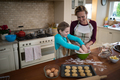 Mother and daughter preparing cookies in kitchen - PhotoDune Item for Sale