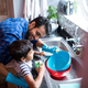 Father and son cleaning utensils at home - PhotoDune Item for Sale
