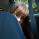 Teenage girl sitting in the back seat of car - PhotoDune Item for Sale