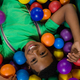 Free Download Overhead view of happy boy in ball pool Nulled