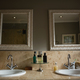 Free Download Mirrors hanging on wall by sink in bathroom Nulled
