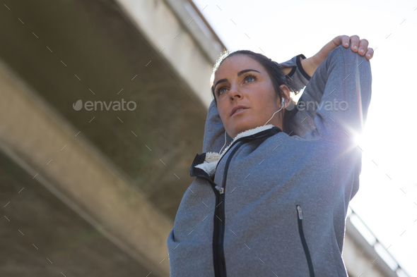 Fit woman doing stretching exercise - Stock Photo - Images