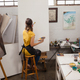 Free Download Woman painting on canvas Nulled