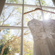 Free Download Low angle view of wedding dress hanging on window in room Nulled
