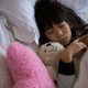 Free Download Girl with toys sleeping in bedroom Nulled