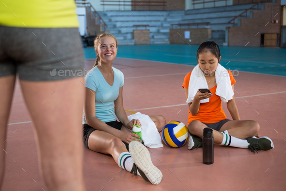 Smiling female players having a break - Stock Photo - Images