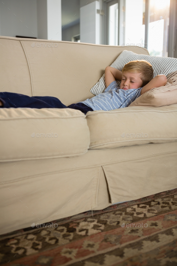 Boy Sleeping On Sofa In The Living Room   Stock Photo   Images