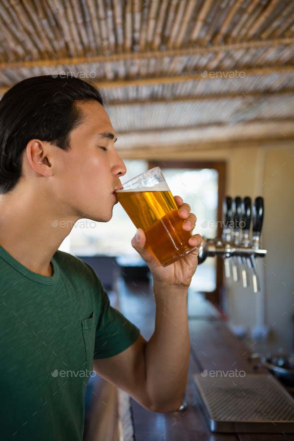 Young man having drinking beer - Stock Photo - Images
