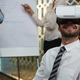 Businessman using virtual reality headset in conference room - PhotoDune Item for Sale