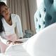 Beautiful woman making bed - PhotoDune Item for Sale