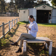 Free Download Female vet using digital tablet while sitting at barn Nulled