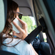 Free Download Woman talking on mobile phone while driving a car Nulled