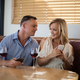 Free Download Couple using mobile phones while having glass of wine Nulled