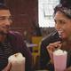 Free Download Friends enjoying milkshakes in cafe Nulled