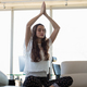 Free Download Young businesswoman doing yoga at office Nulled