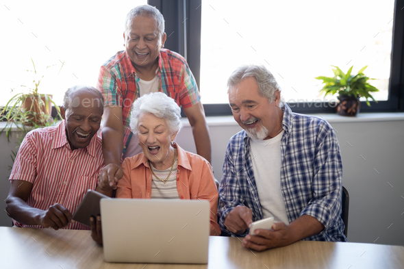 Happy Senior People Using Technology At Nursing Home Stock Photo By Wavebreakmedia