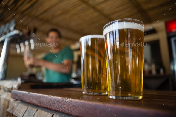 Close-up of beer glasses on counter - Stock Photo - Images