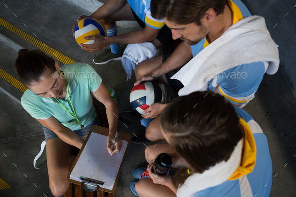 High angle view of coach discussing with volleyball players - Stock Photo - Images