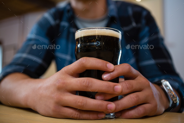 Midsection of customer having drink - Stock Photo - Images