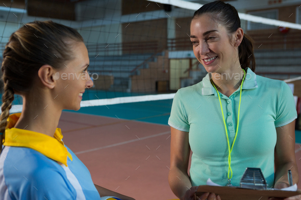 Female coach talking with volleyball player - Stock Photo - Images