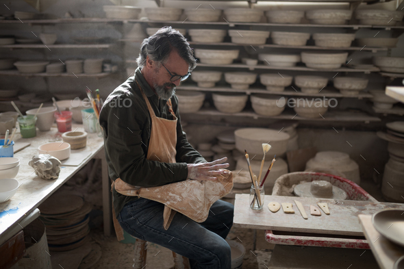 Male potter molding a clay - Stock Photo - Images