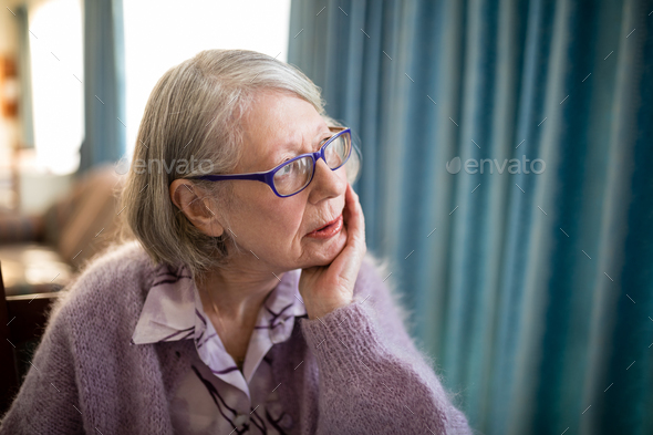 Thoughtful senior woman looking away - Stock Photo - Images