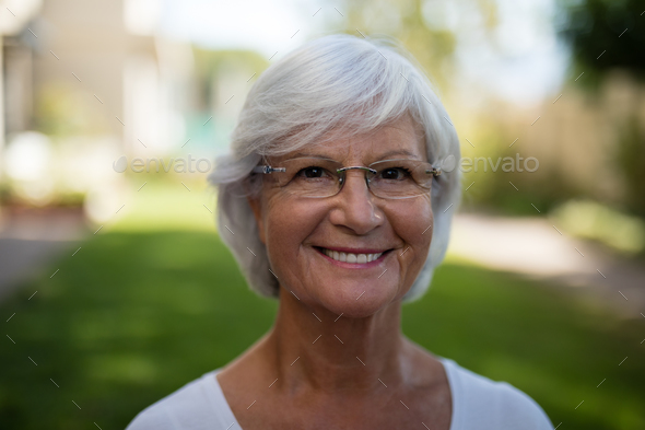 Close-up of smiling senior woman - Stock Photo - Images
