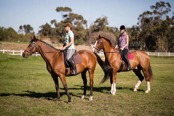 Young Women horseback riding - Stock Photo - Images