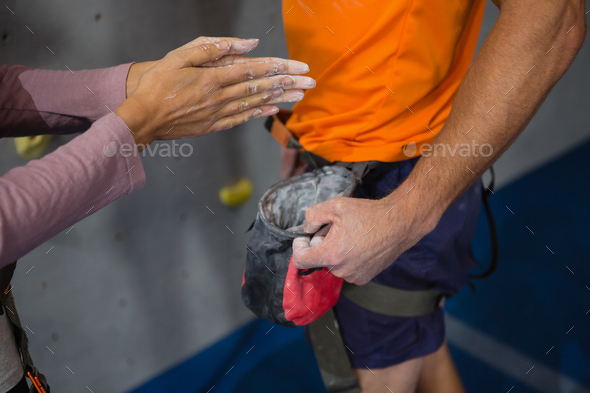 Cropped hand of woman taking chalk powder from trainer - Stock Photo - Images