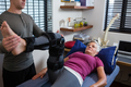 Male physiotherapist giving leg massage to patient - PhotoDune Item for Sale