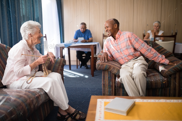 Cheerful senior man talking with woman - Stock Photo - Images