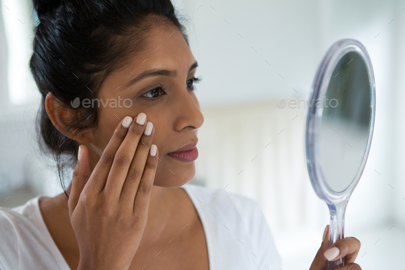 Close-up of woman holding hand mirror - Stock Photo - Images