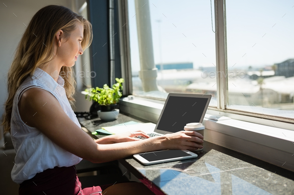 Young businesswoman using laptop - Stock Photo - Images