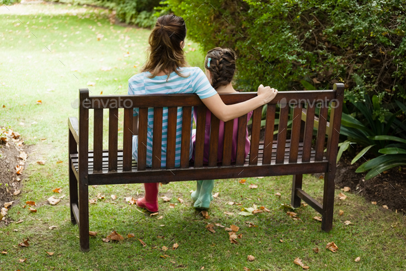 Super Rear View Of Woman And Girl Sitting On Wooden Bench Ocoug Best Dining Table And Chair Ideas Images Ocougorg