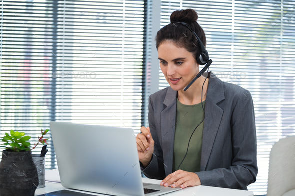 Female executive doing video call on laptop - Stock Photo - Images