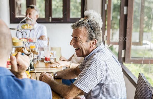 Seniors enjoying breakfast - Stock Photo - Images