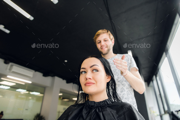 Professional hairdresser discussing female customer preferences in barbershop, choosing new hairdo - Stock Photo - Images