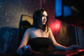 Portrait Shot of a Smiling Beautiful Professional Gamer Girl Playing in First-Person Shooter Online - PhotoDune Item for Sale