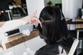 Professional hairdresser, stylist combing hair of female client in professional hair salon. Beauty - PhotoDune Item for Sale