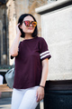 Young stylish girl, wearing fashionable glasses and a t-shirt. Abstract looking to the side. concept - PhotoDune Item for Sale